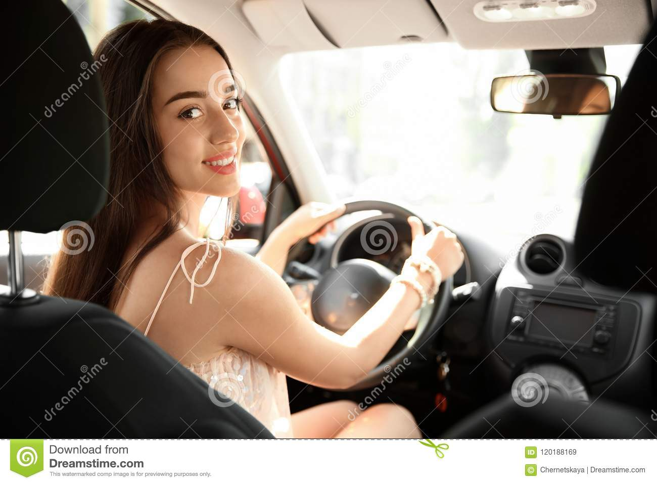 Young woman on driver`s seat