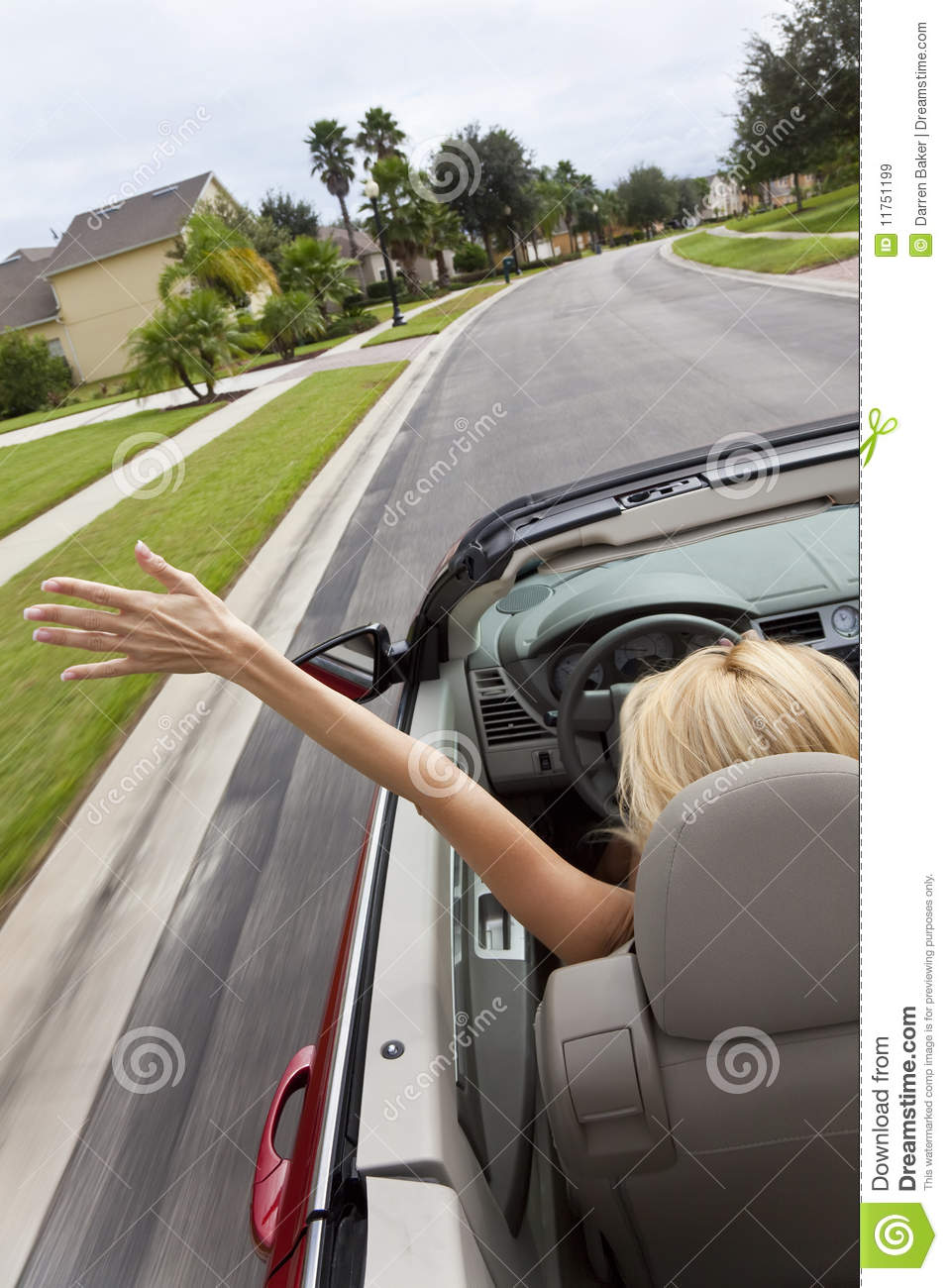 Young woman driving convertible car at speed royalty free stock images