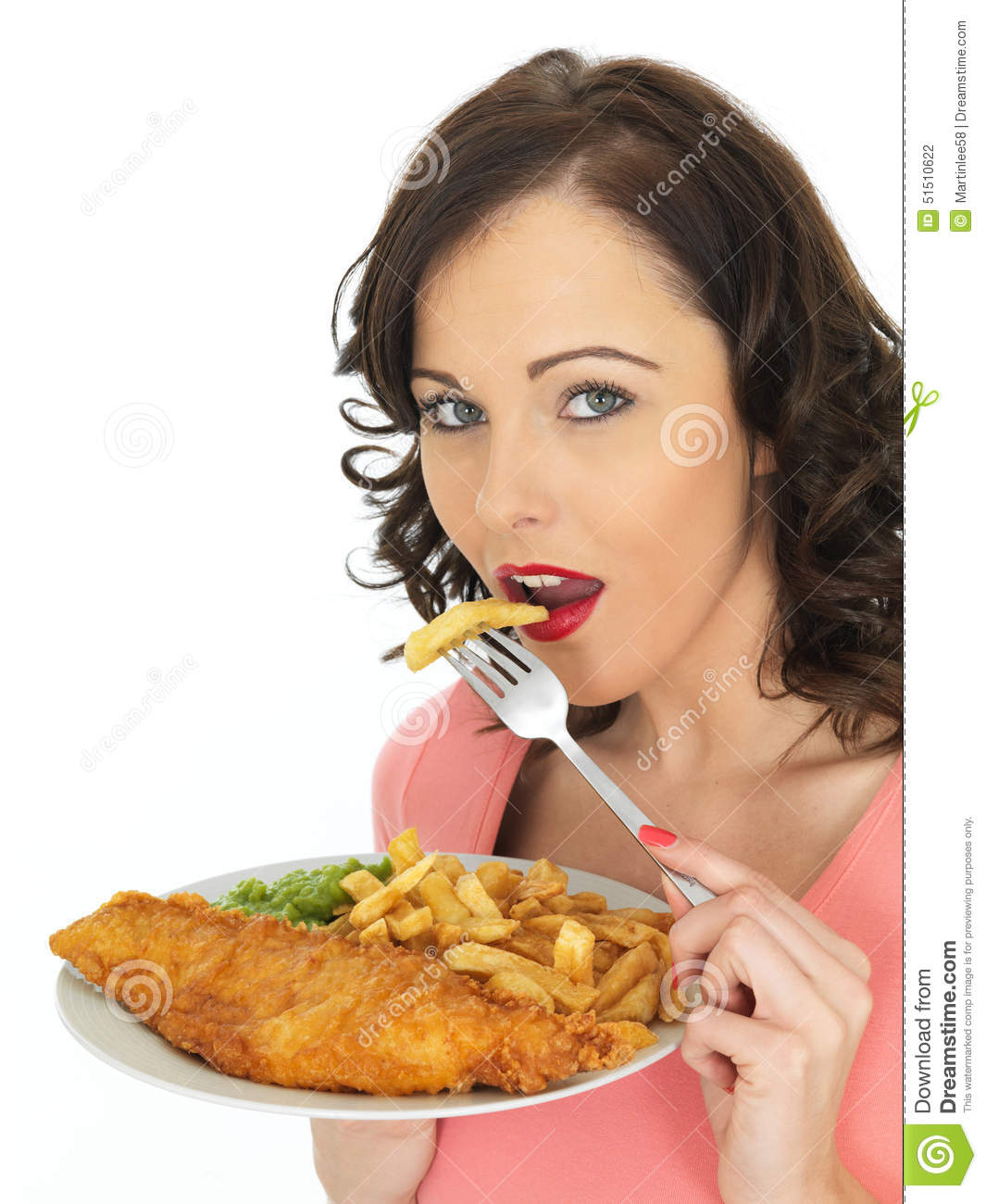 Young woman eating fish and chips with mushy peas stock for Dreaming of eating fish