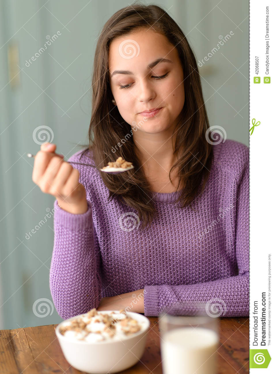 Young Woman Eating Healthy Cereal Breakfast Stock Image