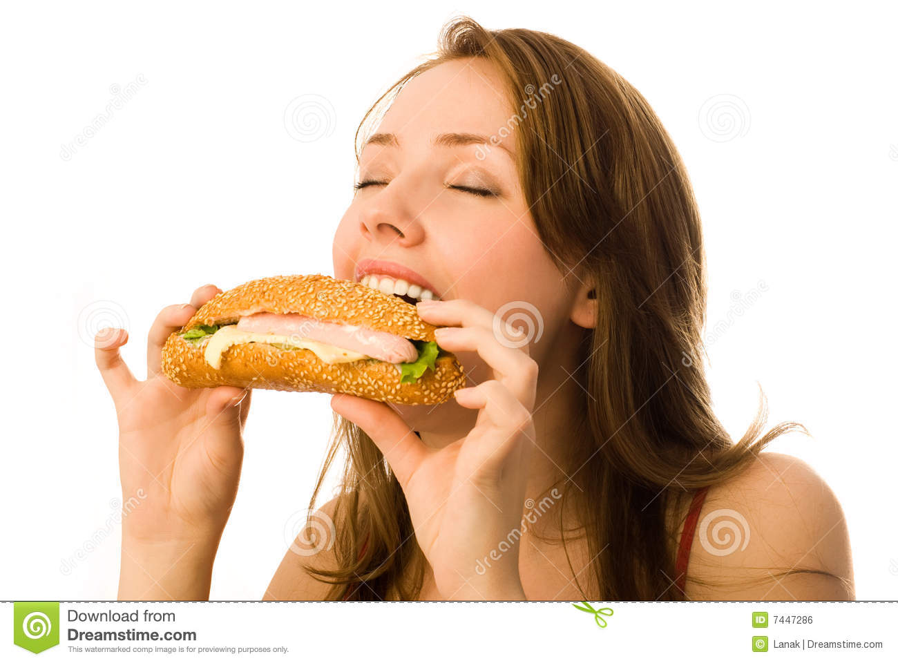 Young woman eating a hot-dog
