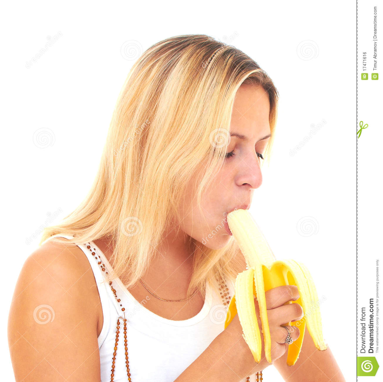 Sexy blonde eating banana
