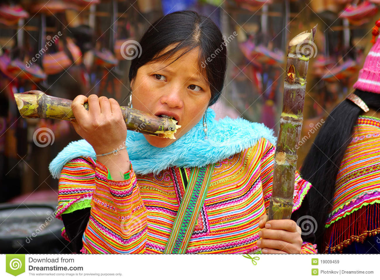 The Young Woman Eats A Sugar Cane Editorial Stock Image ...