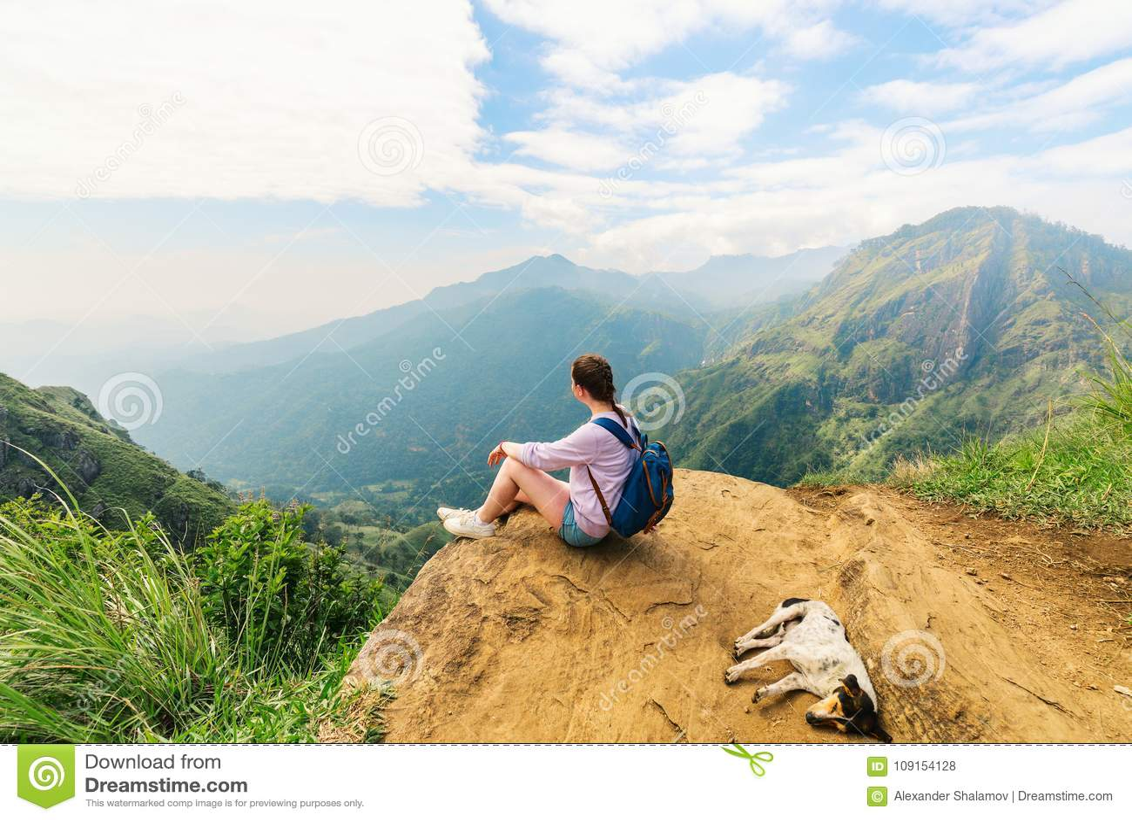 182afcfdb Young woman enjoying breathtaking views over mountains and tea plantations  from Little Adams peak in Ella Sri Lanka