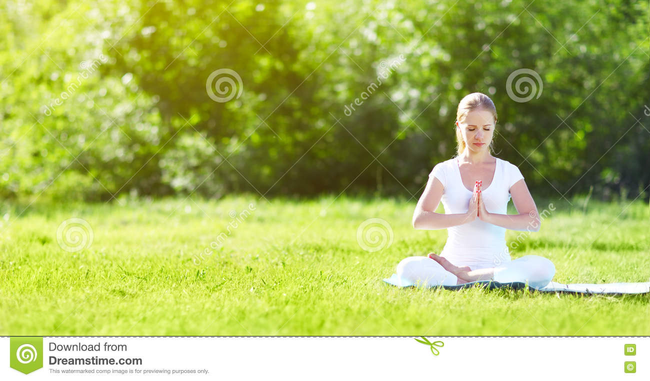 Stock photo: Woman meditating in forest sitting in