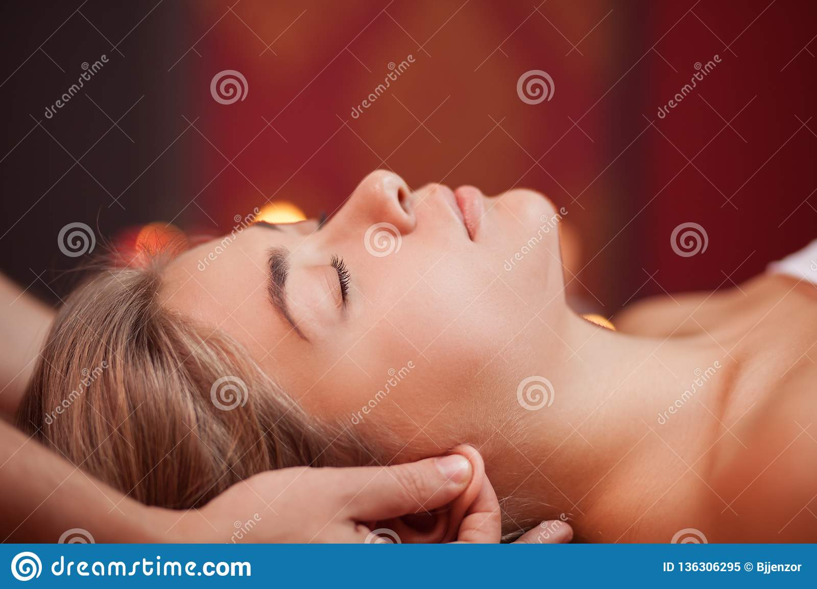 Young woman enjoying professional massage