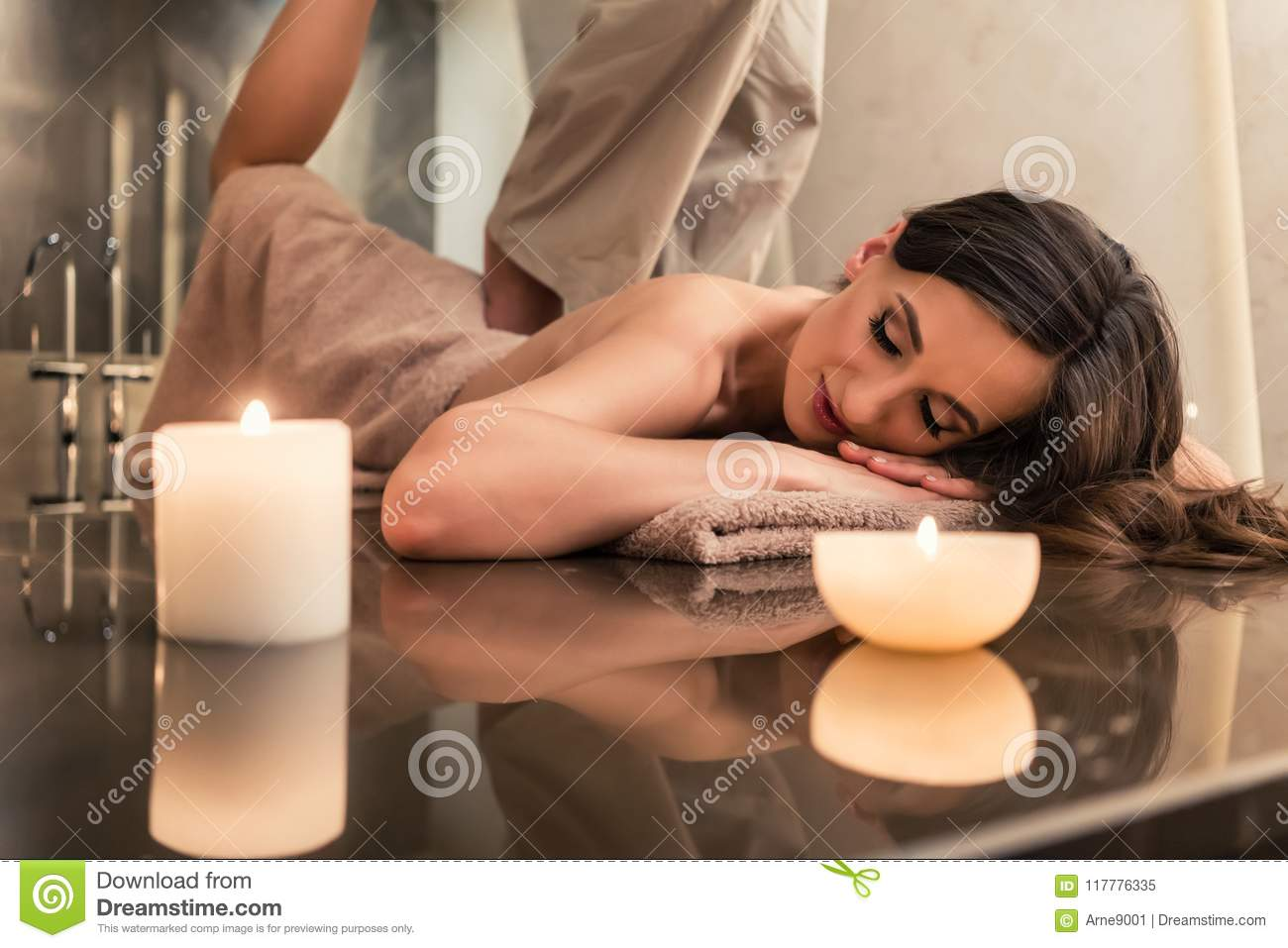 Young woman enjoying the stretching techniques of Thai massage