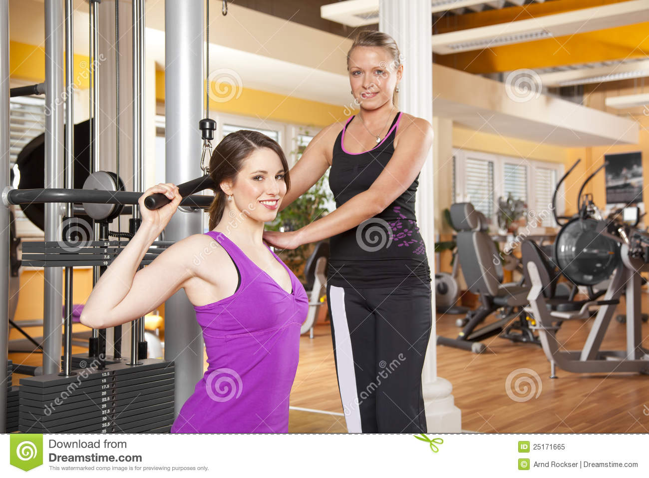 Young Woman Exercising In Gym With
