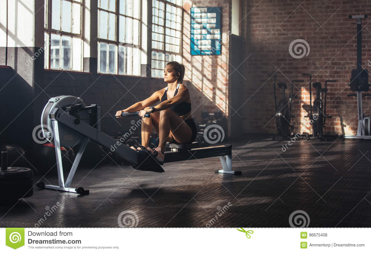 Young woman exercising in gymnasium.