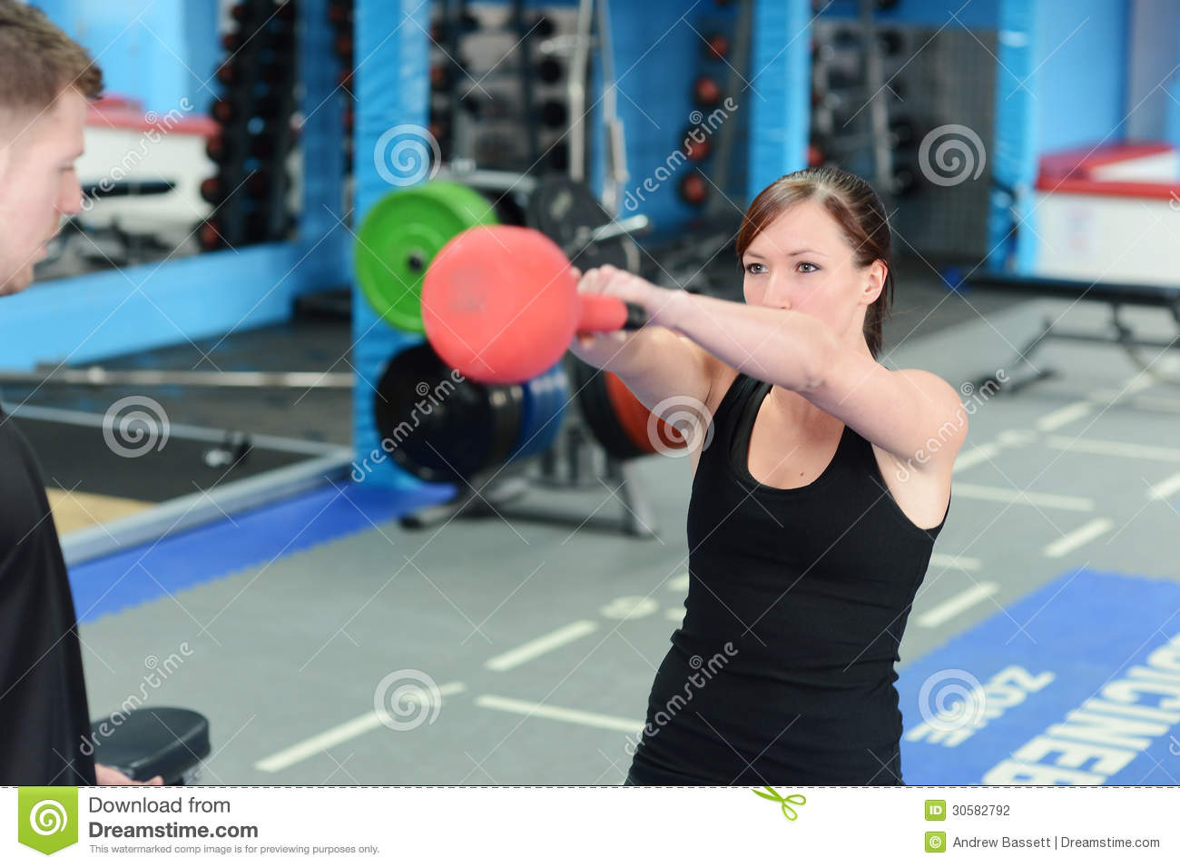Young Woman Exercising With Kettle Bell Weight Stock ...