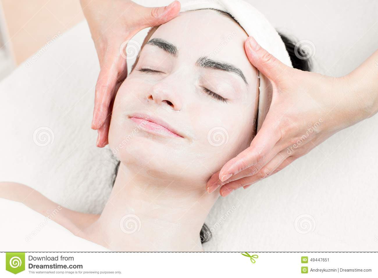 Young woman face massage in spa parlour