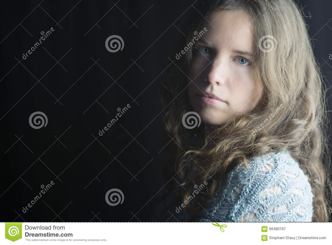 Young Woman With Fair Skin Blue Eyes And Light Brown Curly Hair In