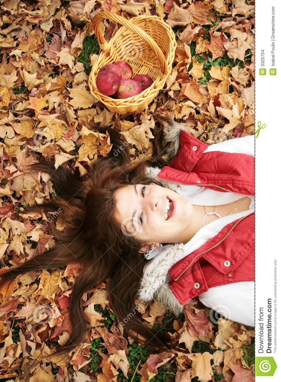 Young woman in fall leaves