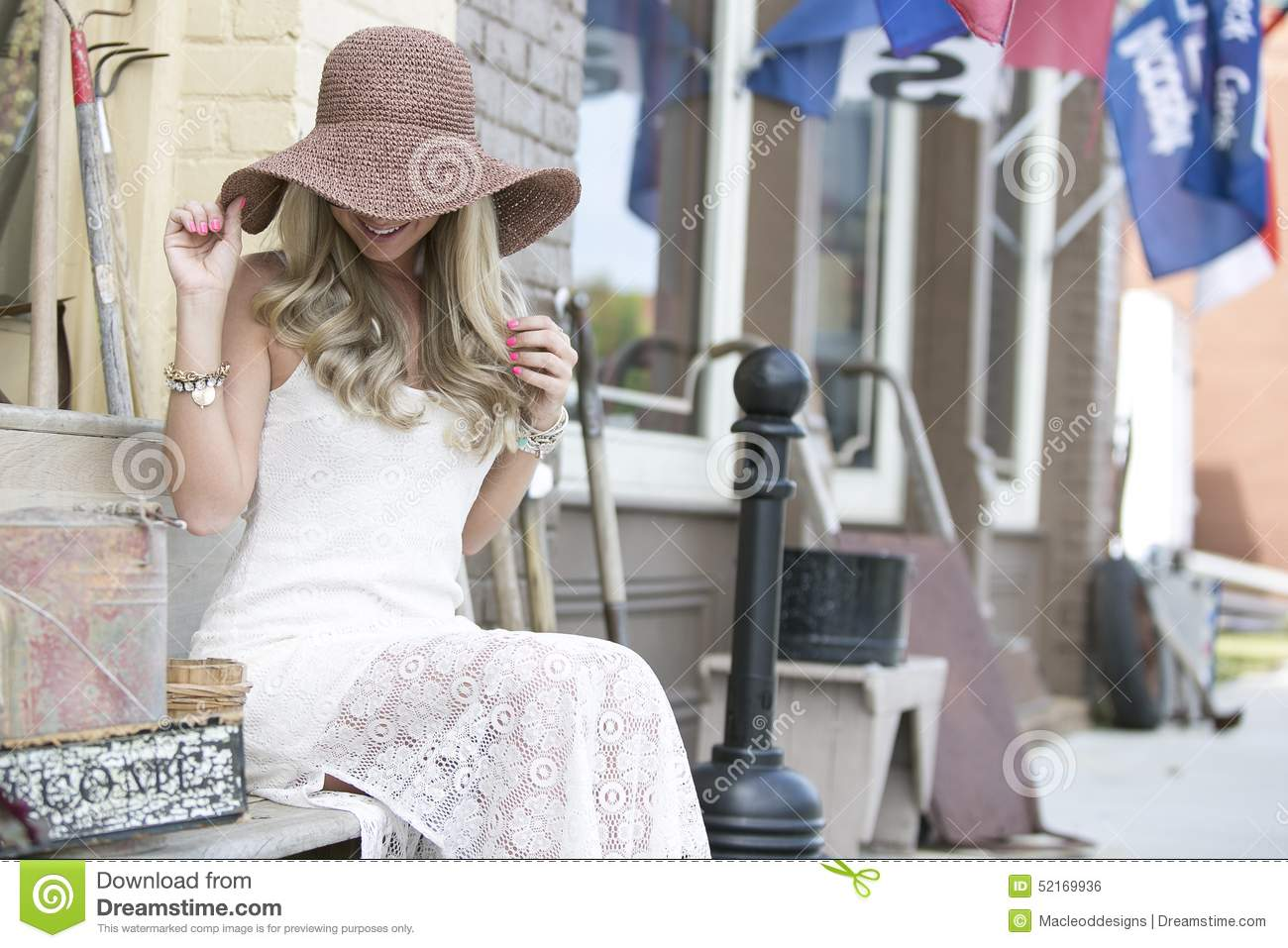 Young woman with fashionable hat