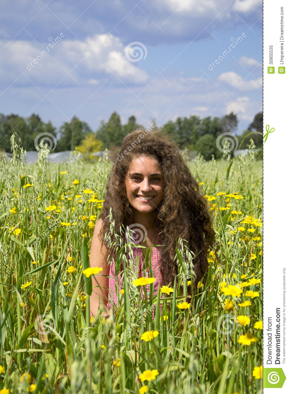 Young Woman On A Field Of Flowers Stock Image - Image ...