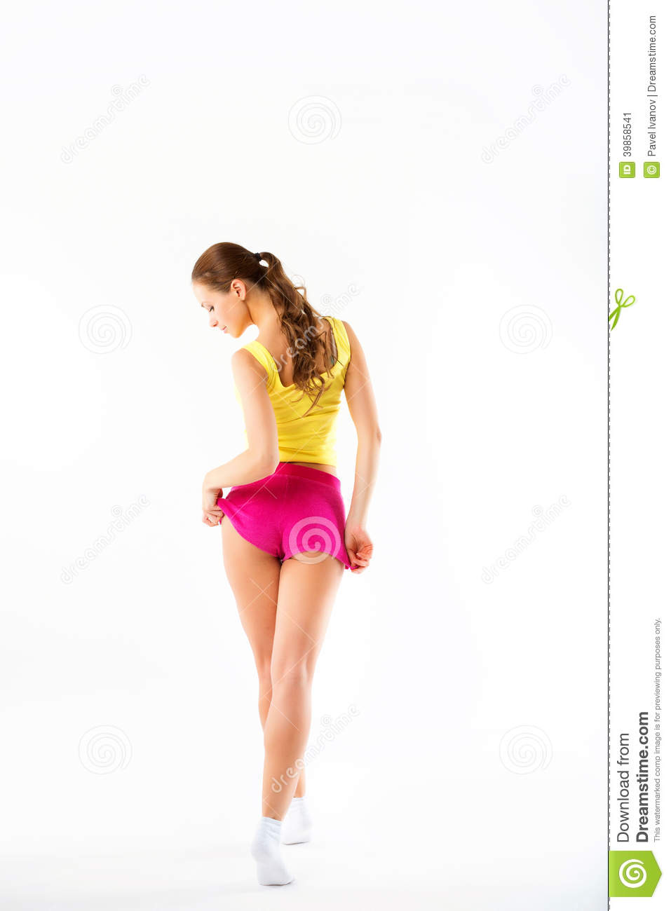 Young woman fitness. Full length from back in sportswear on a white background