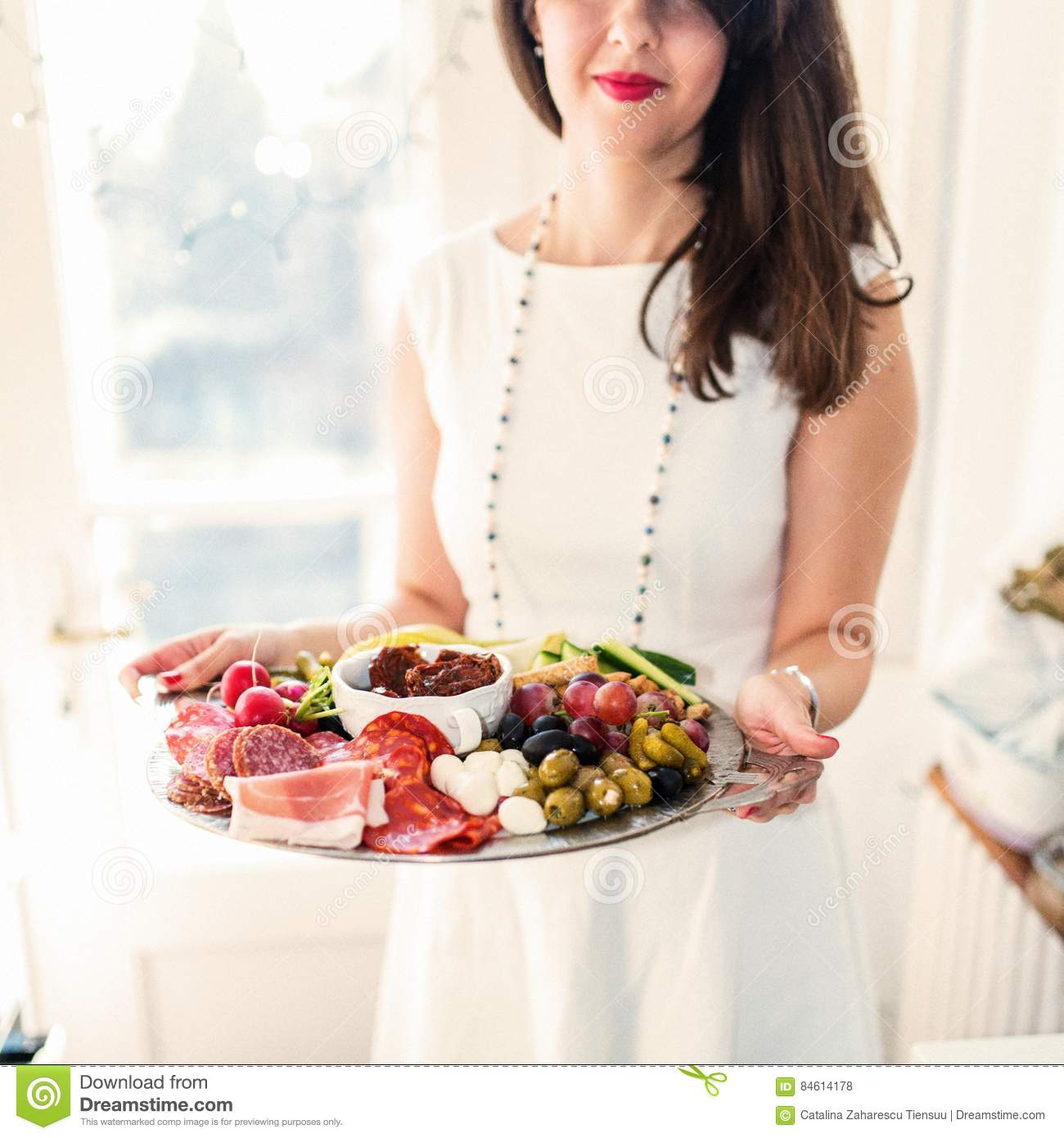 Young woman with food platter