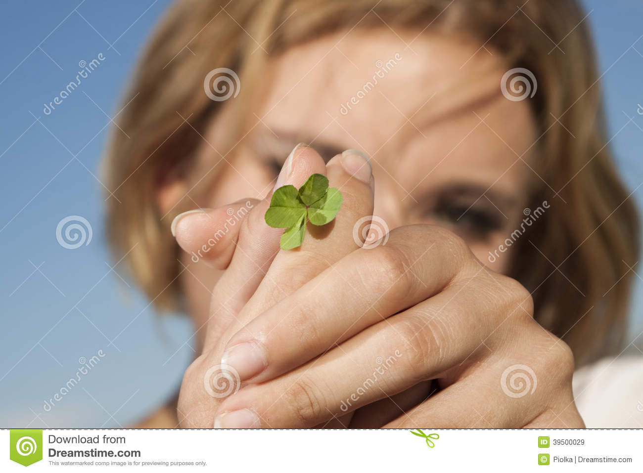 Young woman with four-leaf clover