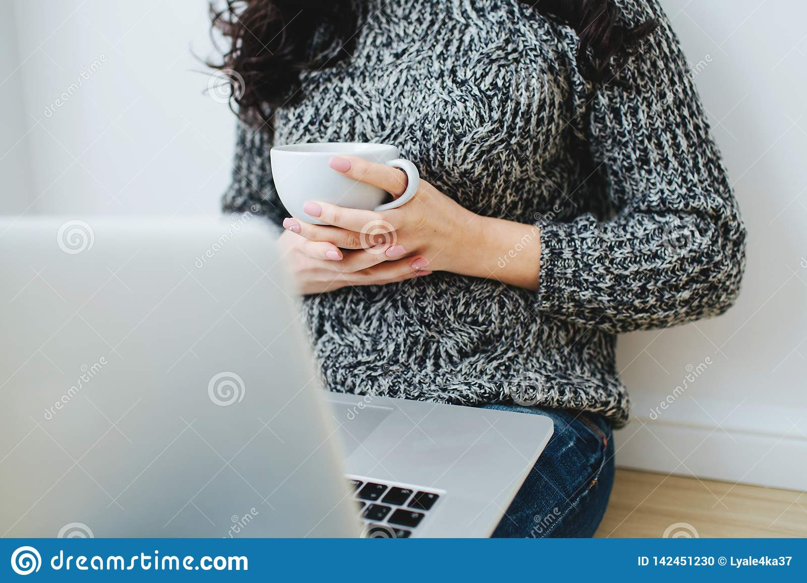 Young woman freelancer working on a laptop