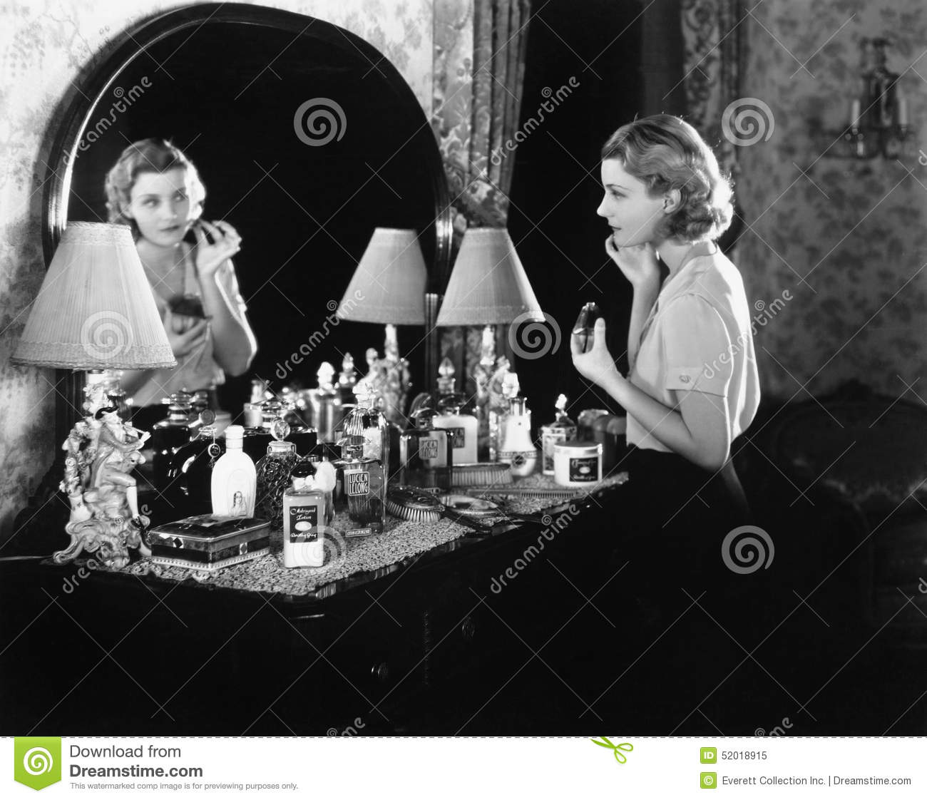 Young Woman In Front Of Her Vanity Applying Make Up Stock