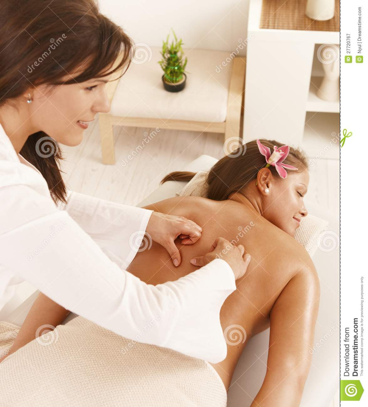 Young woman getting deep tissue massage