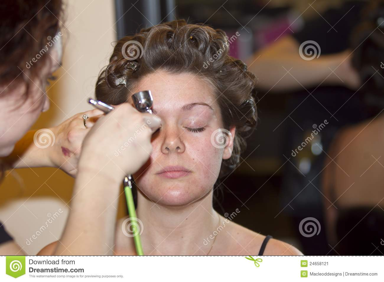 Young Woman Getting Makeup Done Stock Image