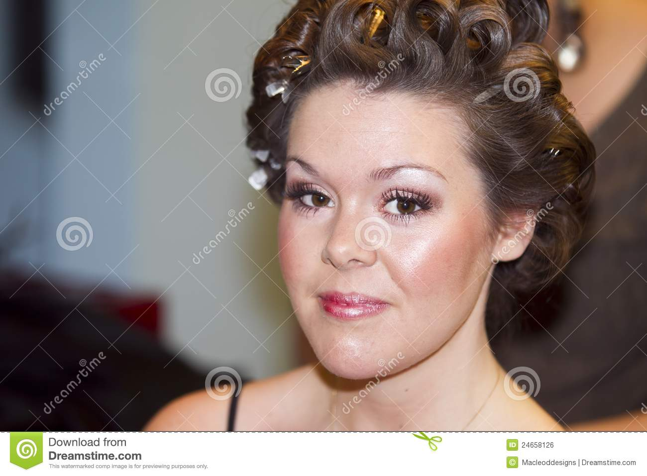 Young Woman Getting Makeup Done Royalty Free Stock Image