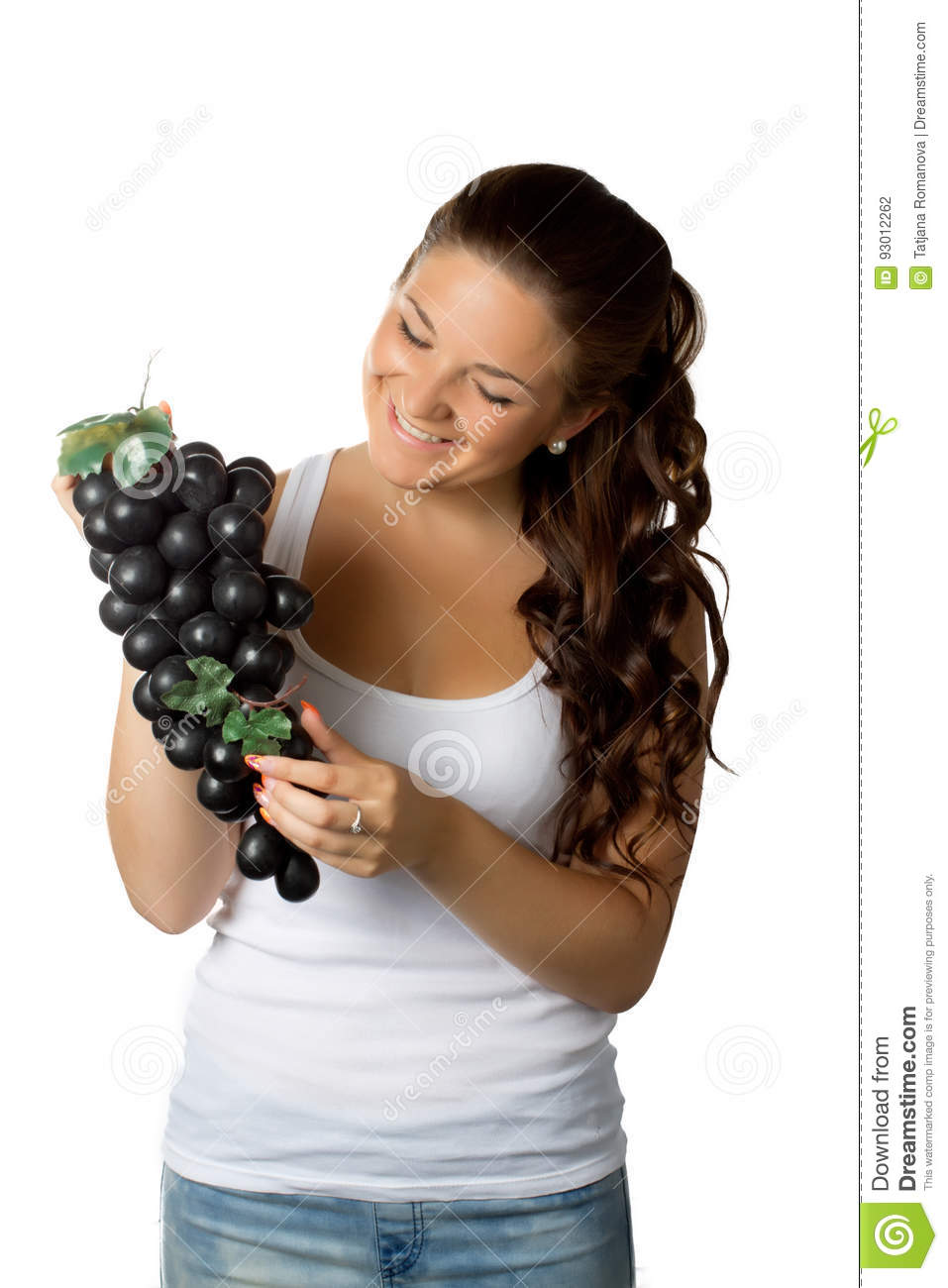 Young woman and grapes on white