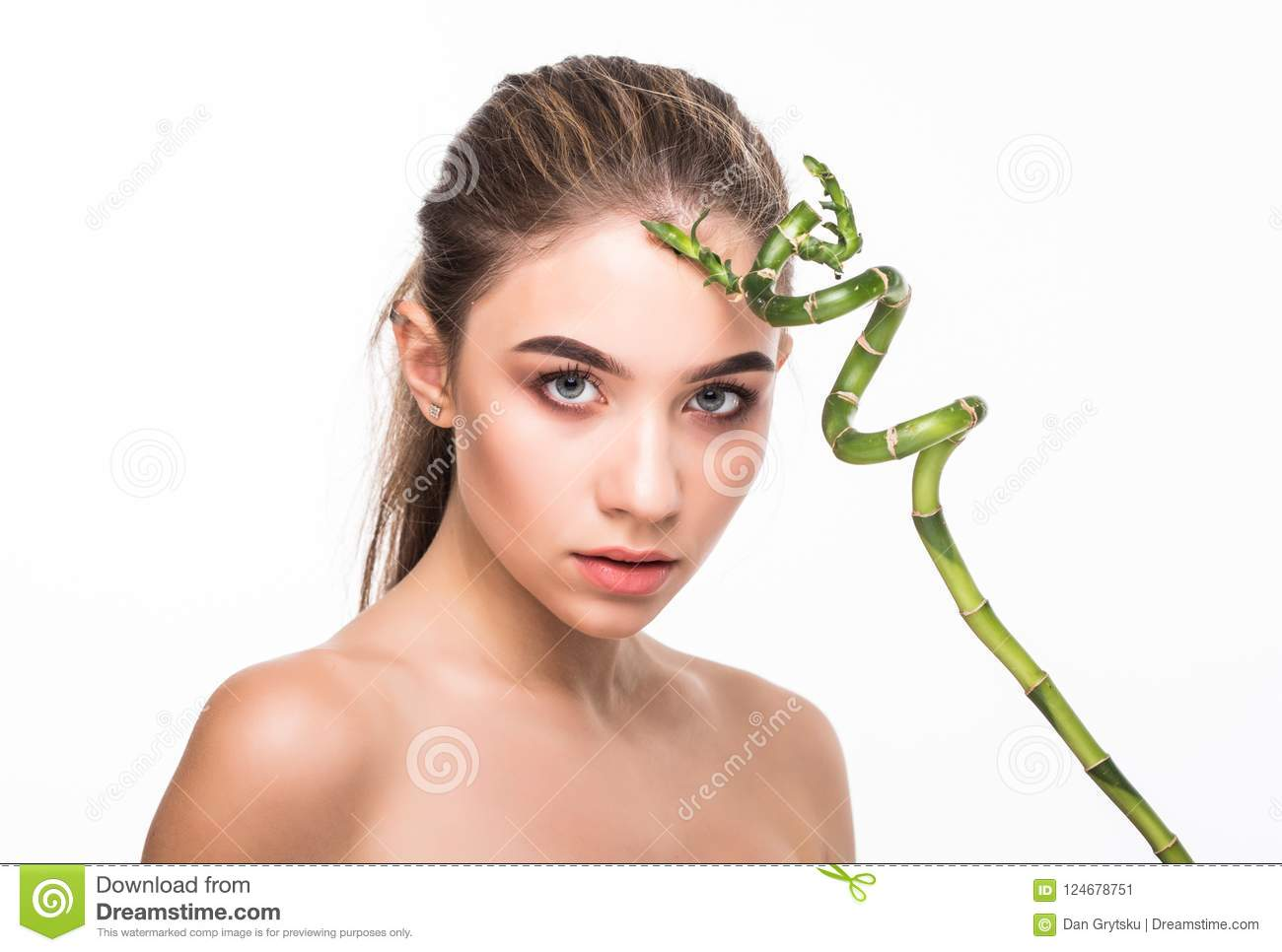 Young woman with green leaf, isolated on white. Beauty natural make up. Spa and wellness and skin care concept. Close up, selectiv