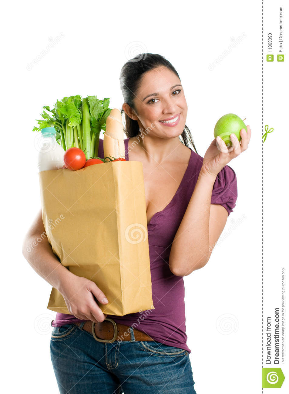 Young woman with grocery bag and green apple