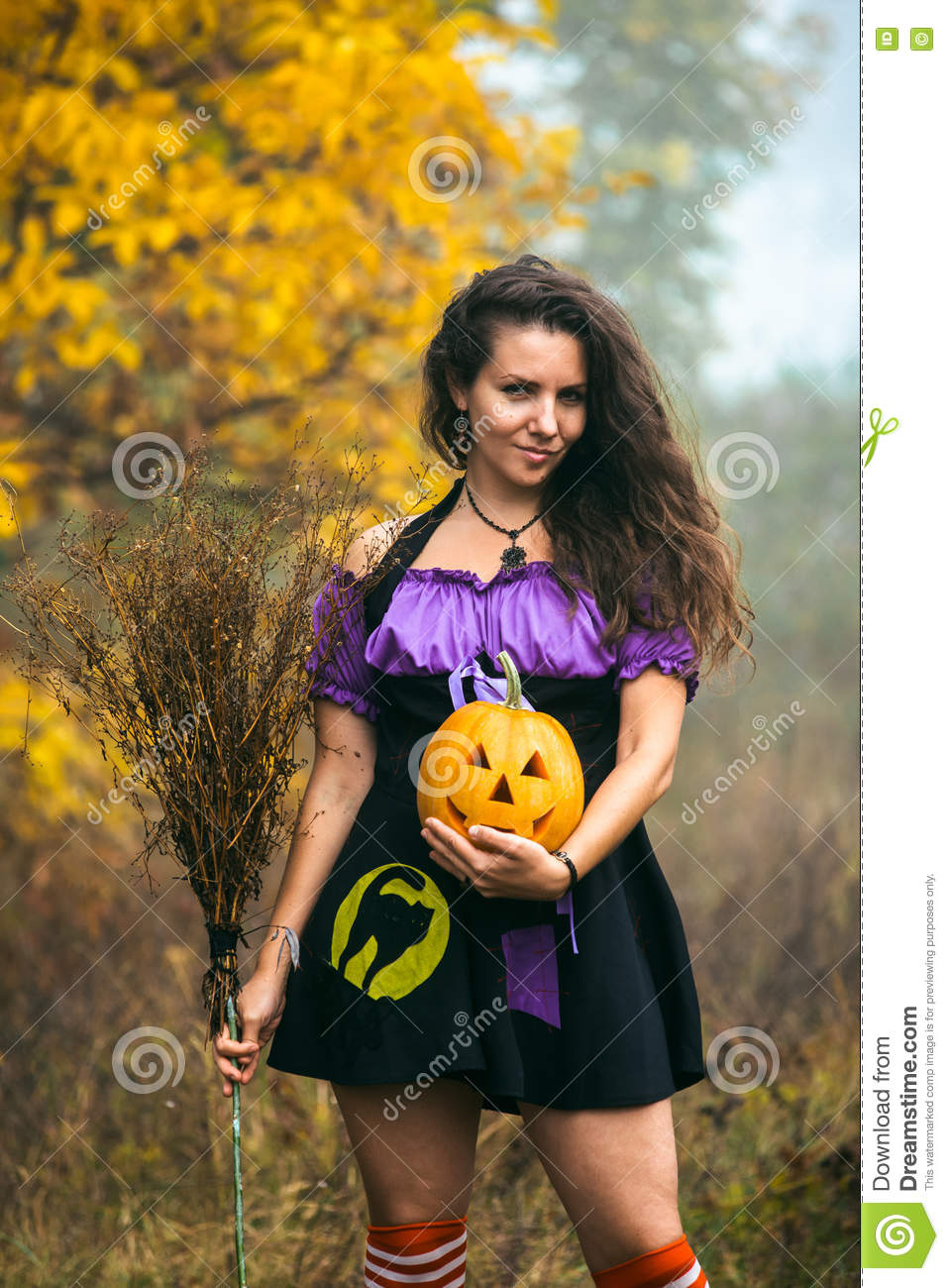 Young Woman In Halloween Witch Costume In The Autumn Forest With ...