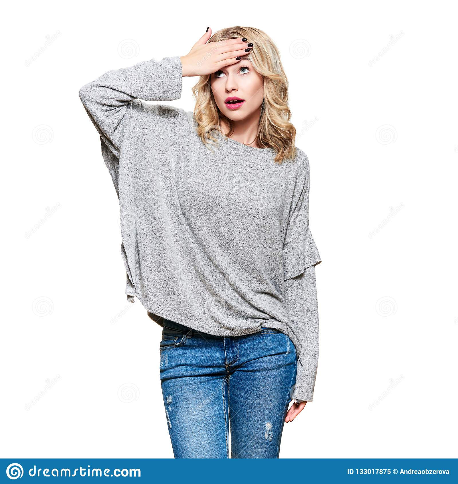 Young woman with hand on her forehead, dissapointed with incredible news, isolated on white background. Human emotions.