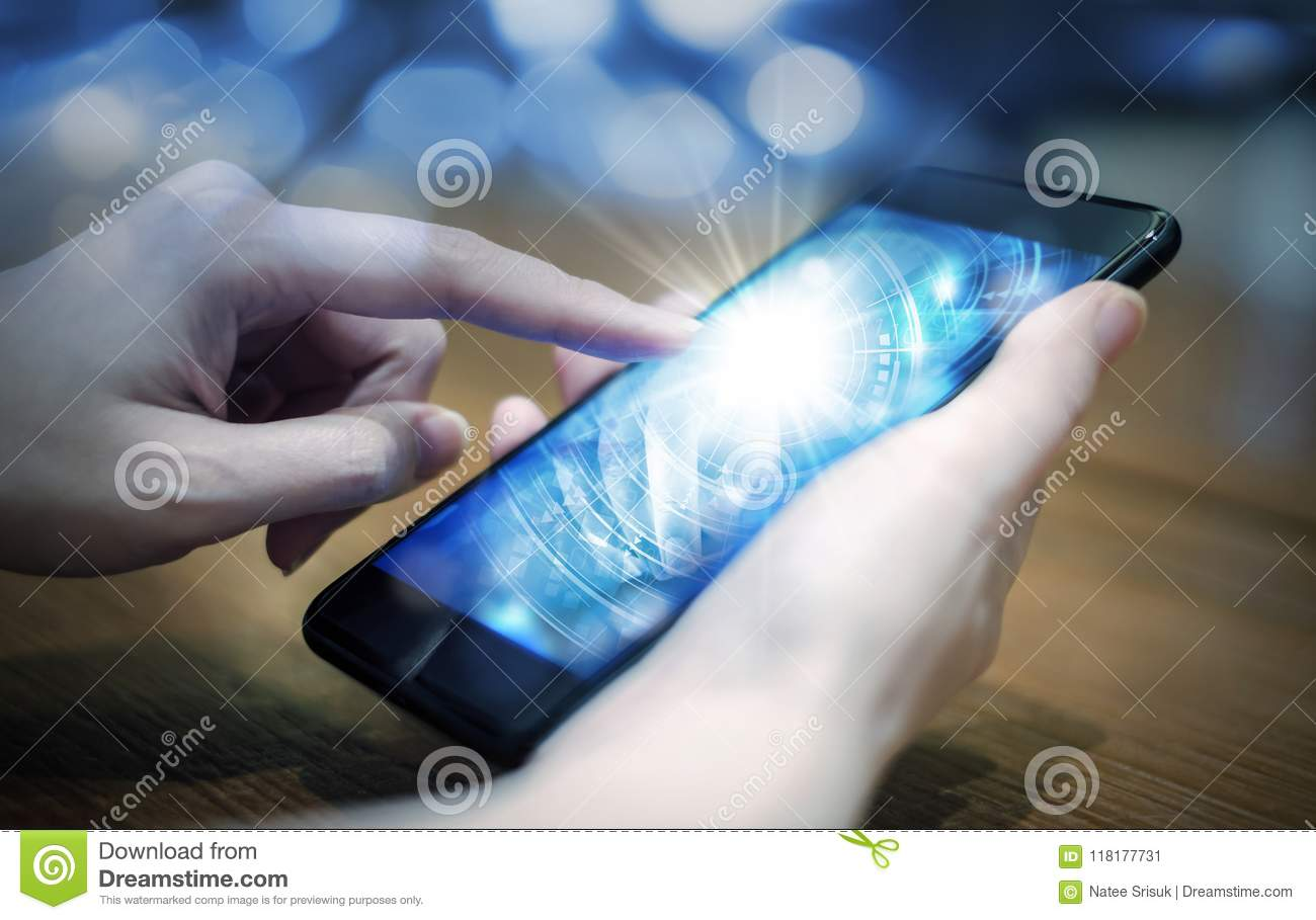Young woman hand touching digital technology in mobile phone