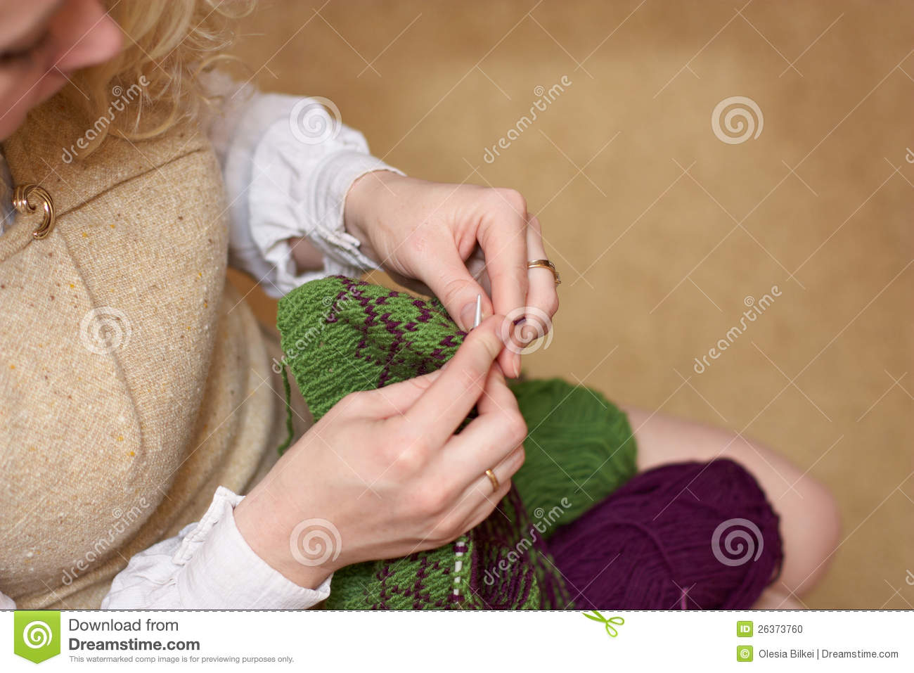 Knitting With Hands Only : Young woman hands knitting with two coloured wool stock