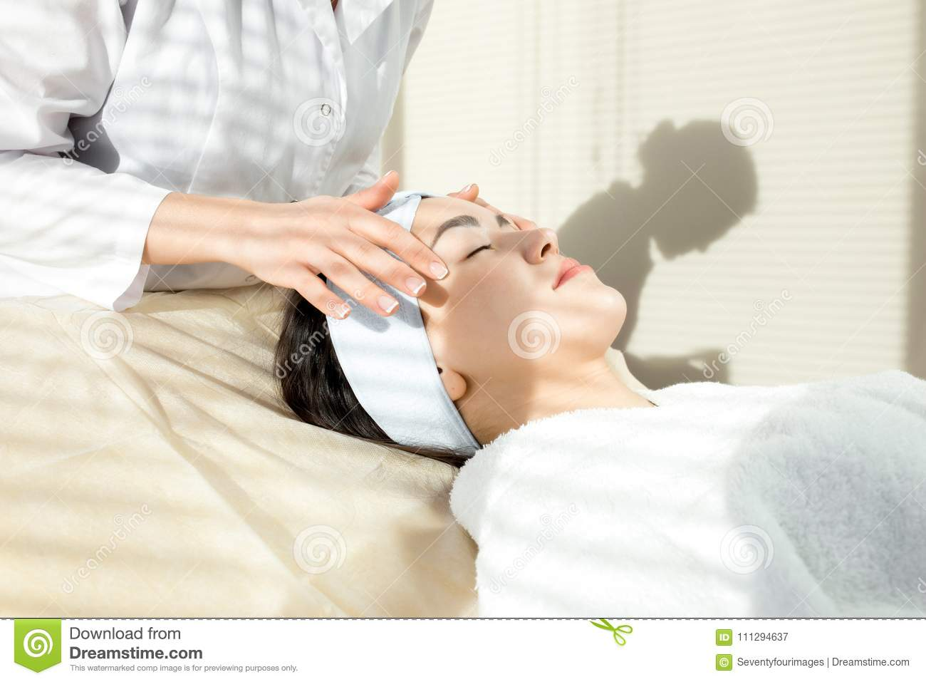 Young Woman Having Facial Massage