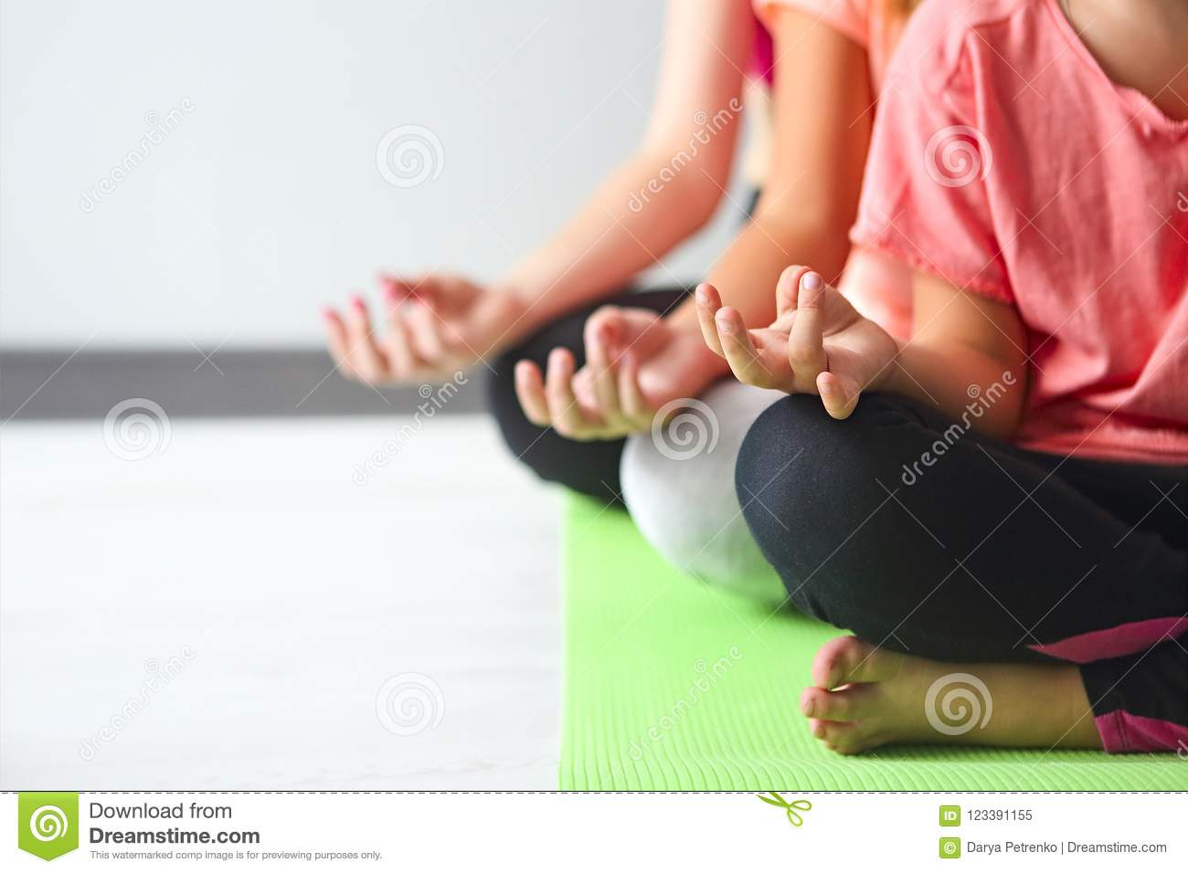 Young woman having fun with kids doing yoga. Family sport concep