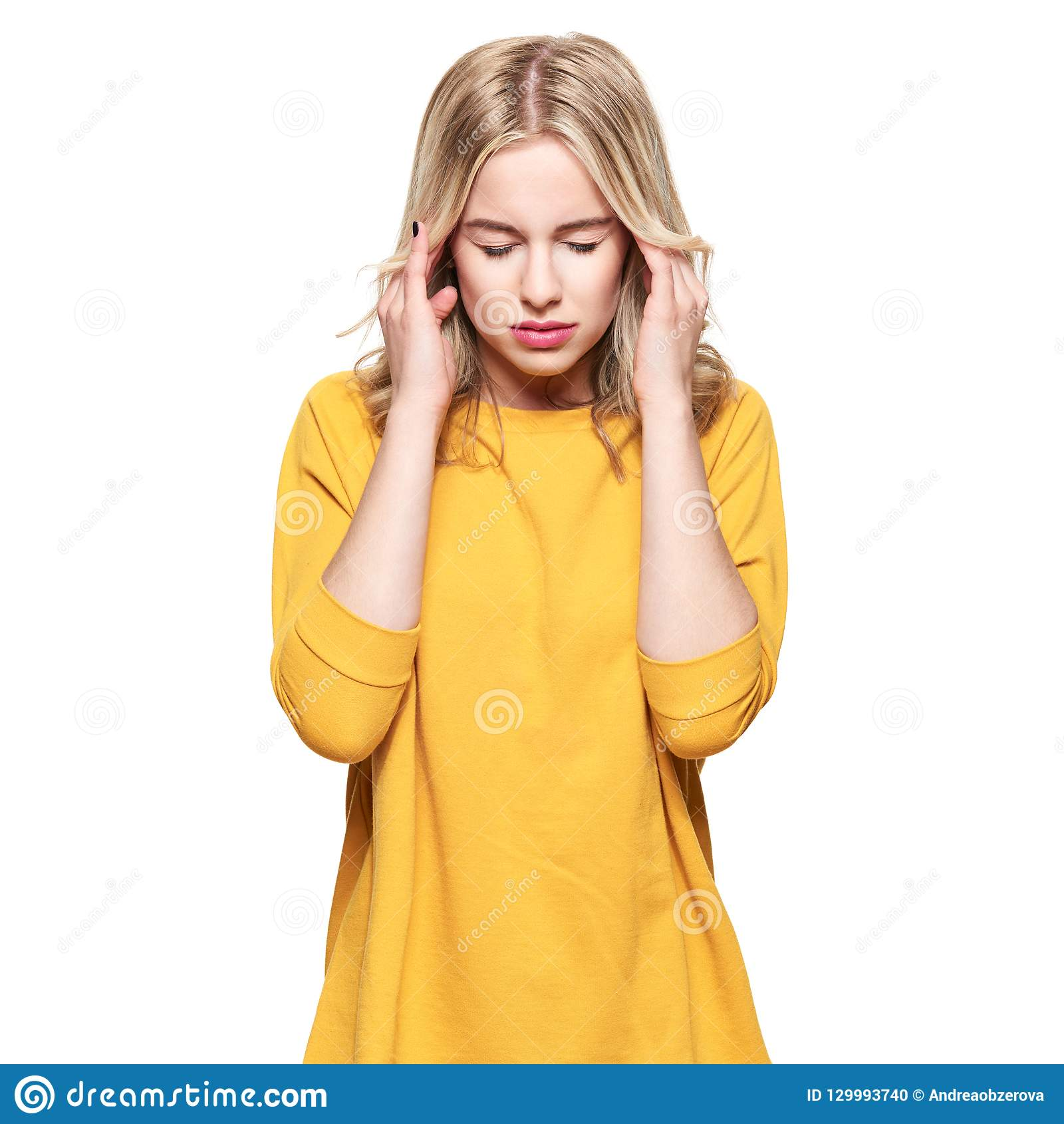 Young Woman Having Headache. Stressed Exhausted Young Woman massaging her temples. Woman Suffering From Migraine.
