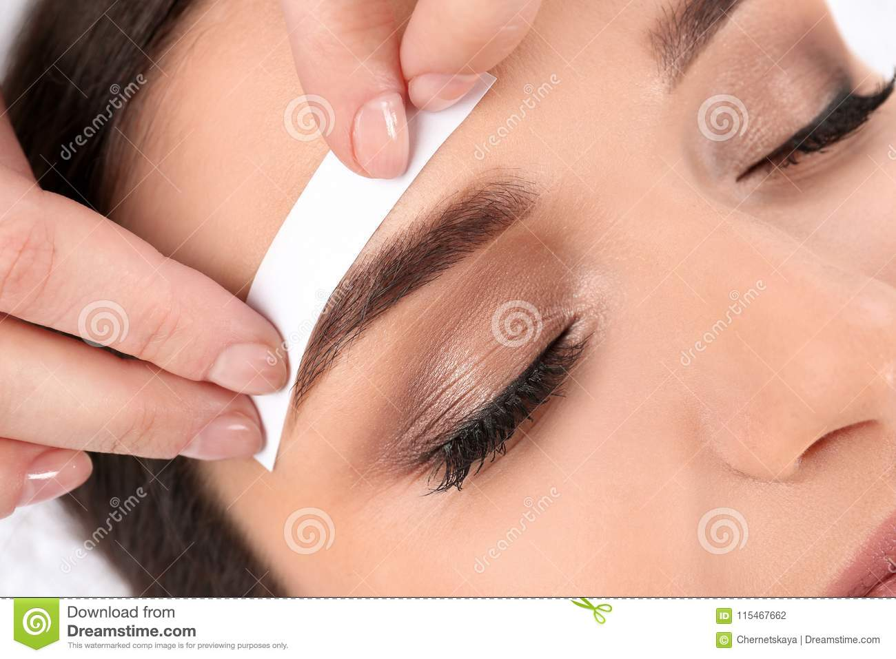 Young woman having professional eyebrow