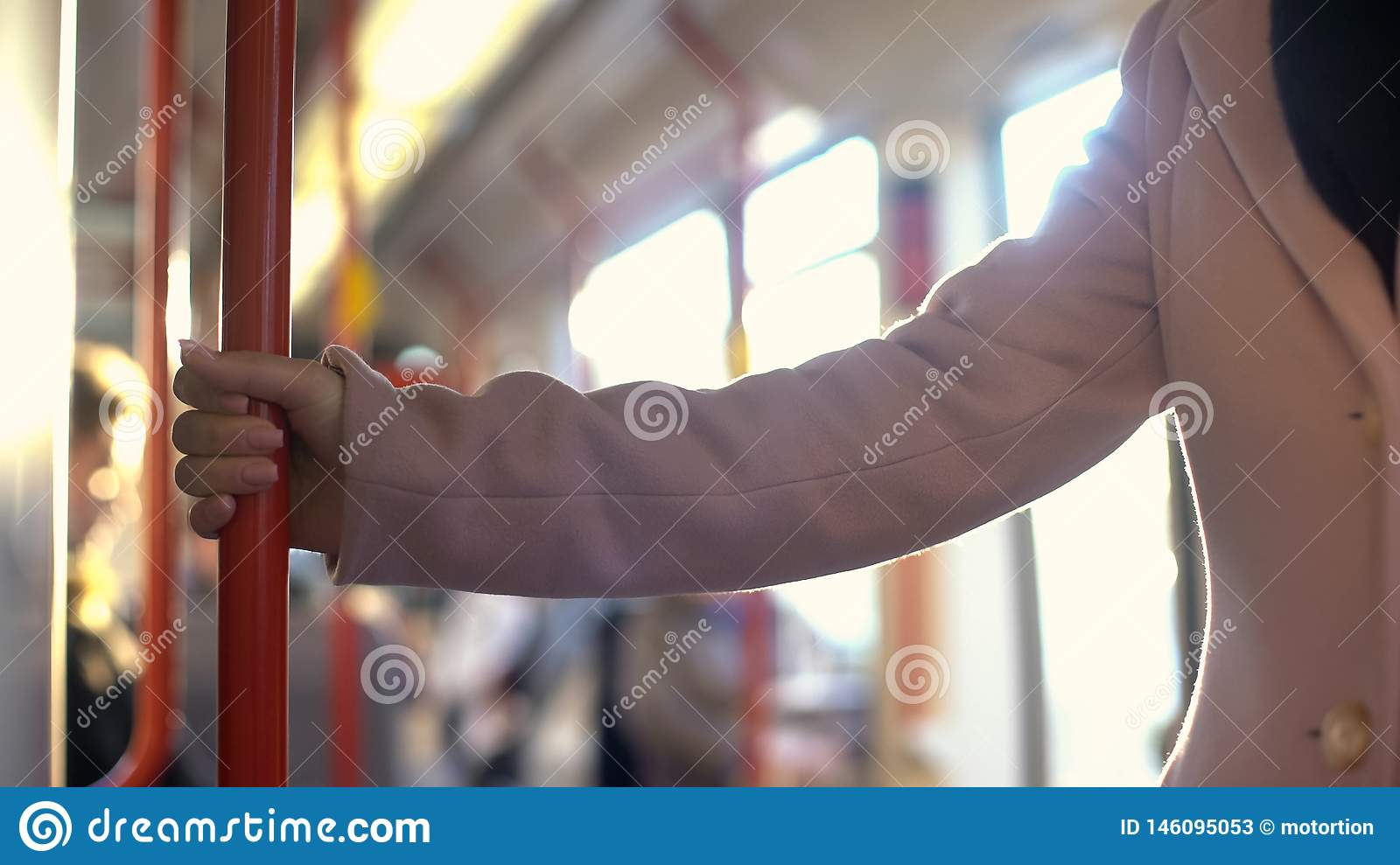 Young woman having ride in subway carriage, everyday commuting routine, railroad