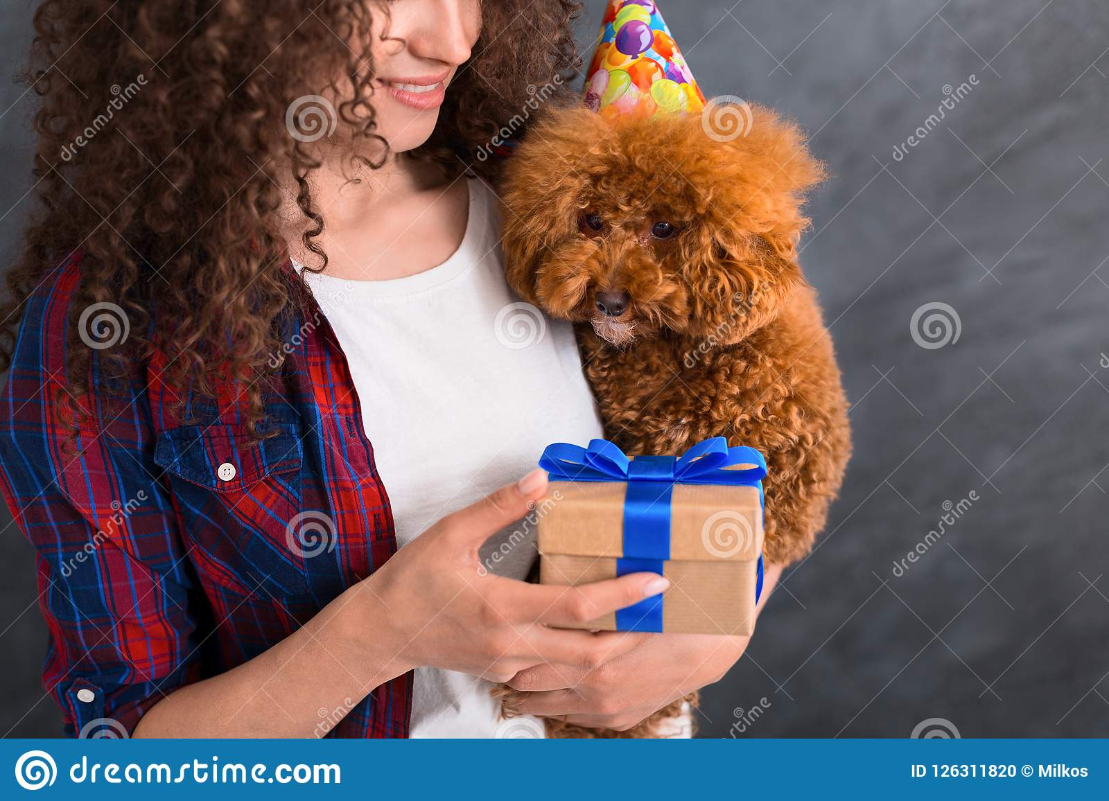 Young woman and her dog celebrate birthday