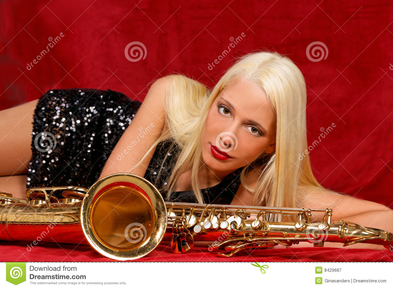 Young woman with her Saxophones