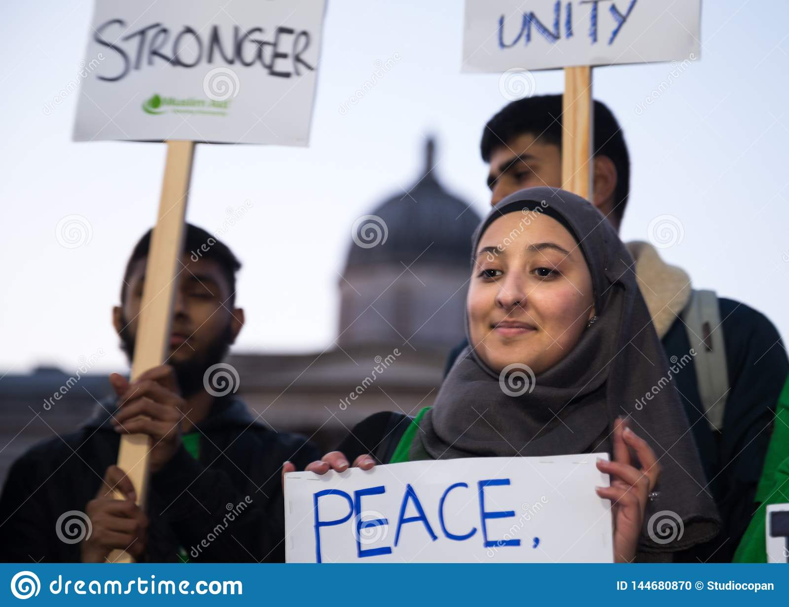 Young Woman in Hijab Holding Sign After 2017 Westminster Bridge Attack