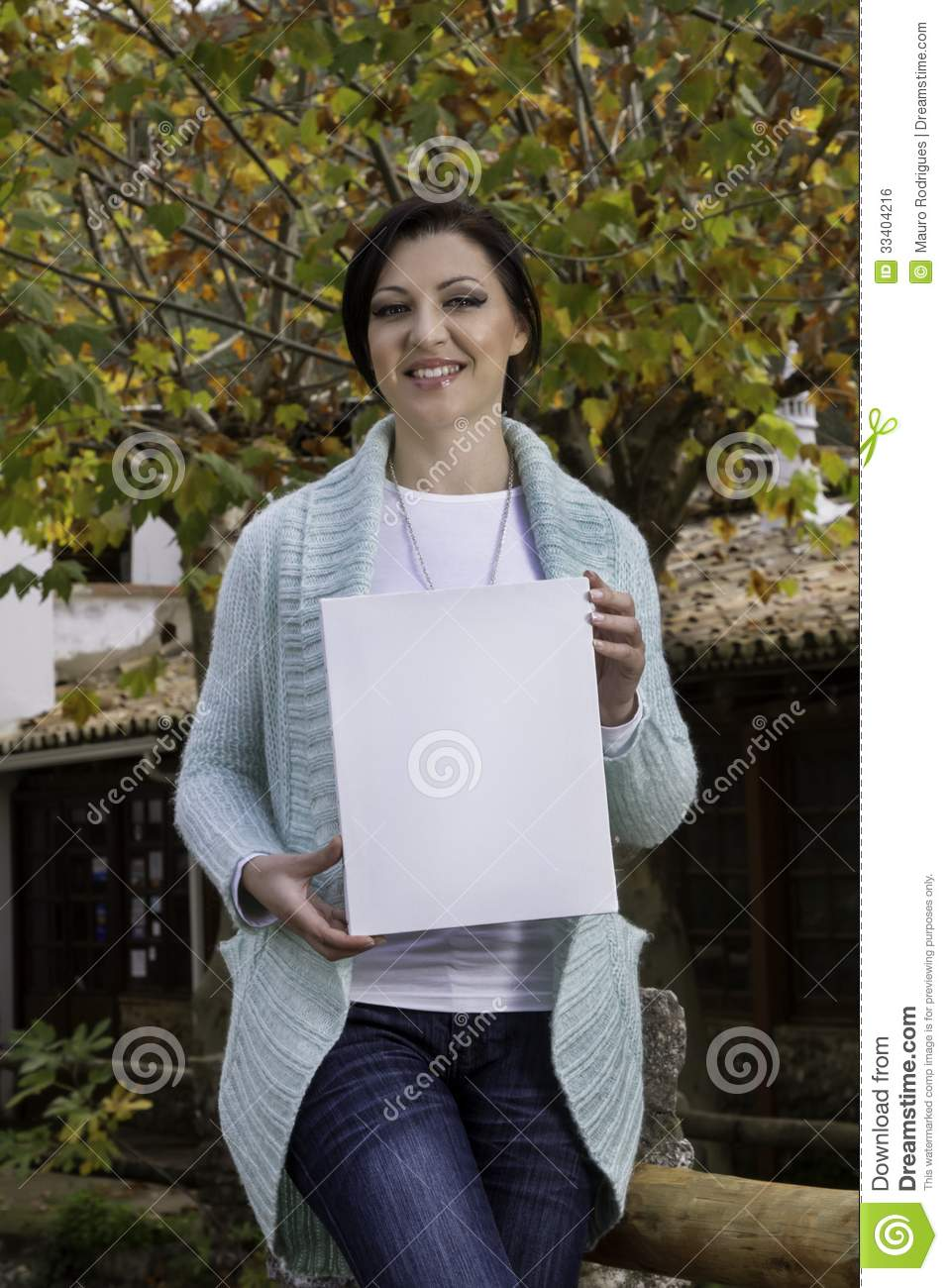 Young woman holding a blank canvas