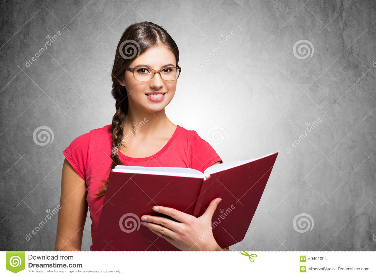Young Woman Holding A Book Stock Photo Image Of Graduate