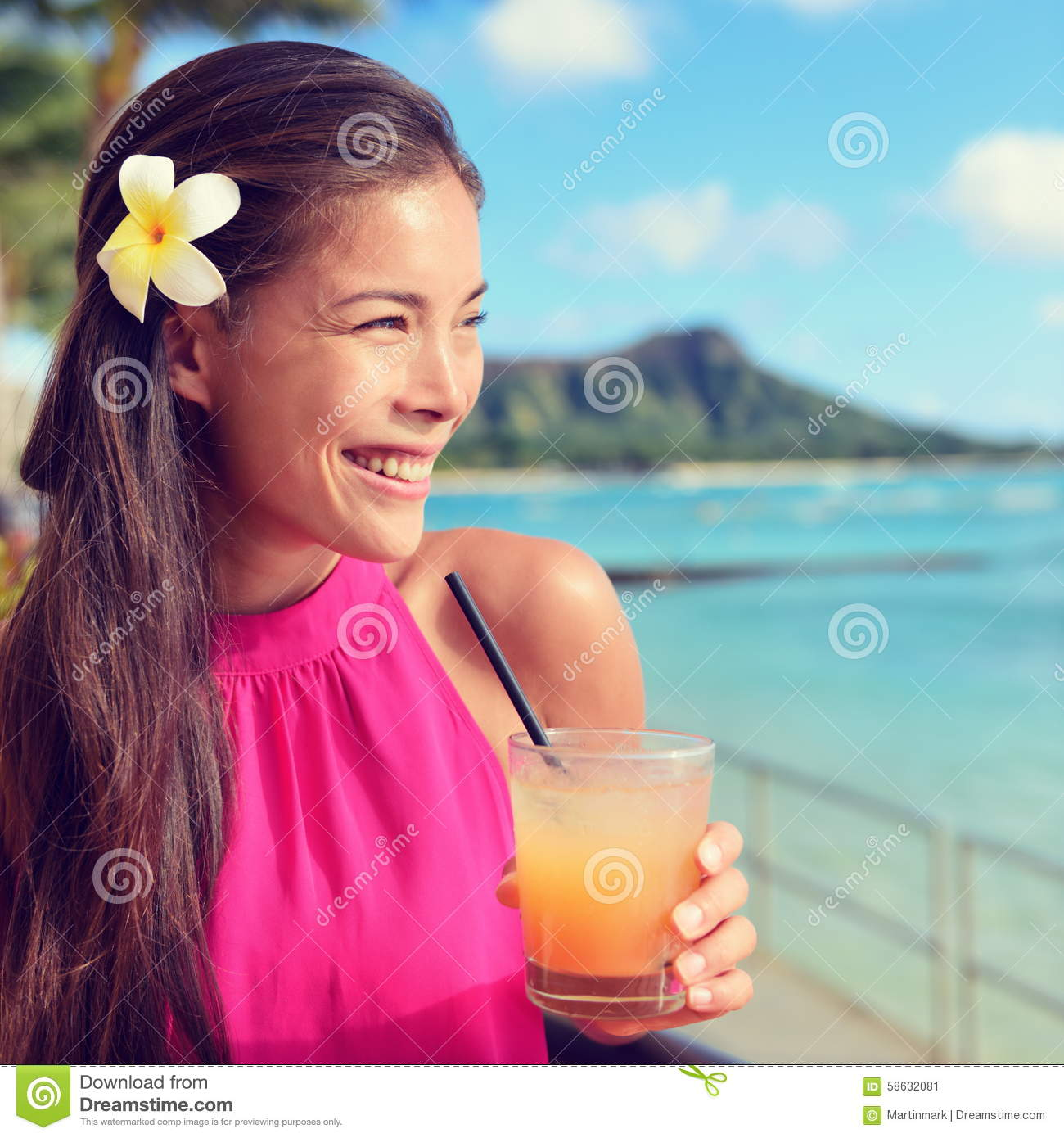 Happy Beautiful Woman Enjoying At Beach Stock Photo: Young Woman Holding Cocktail Glass At Beach Bar Stock