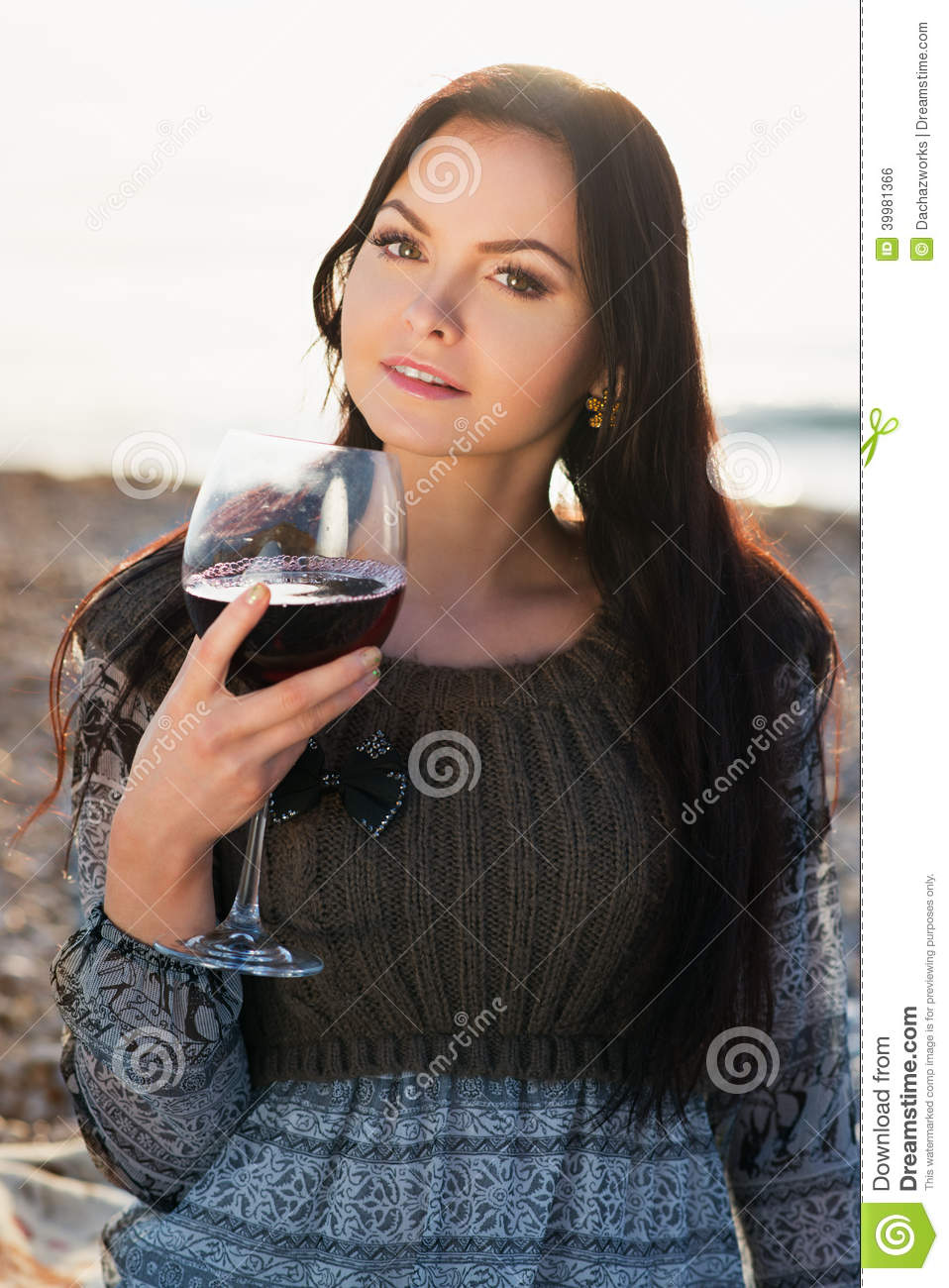 Young Woman Holding Glass Of Red Italian Wine Stock Photo ...
