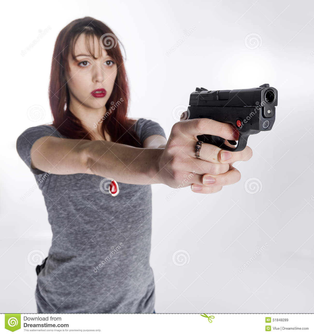 Young Woman Holding Hand Gun With Both Hands Stock Image ...