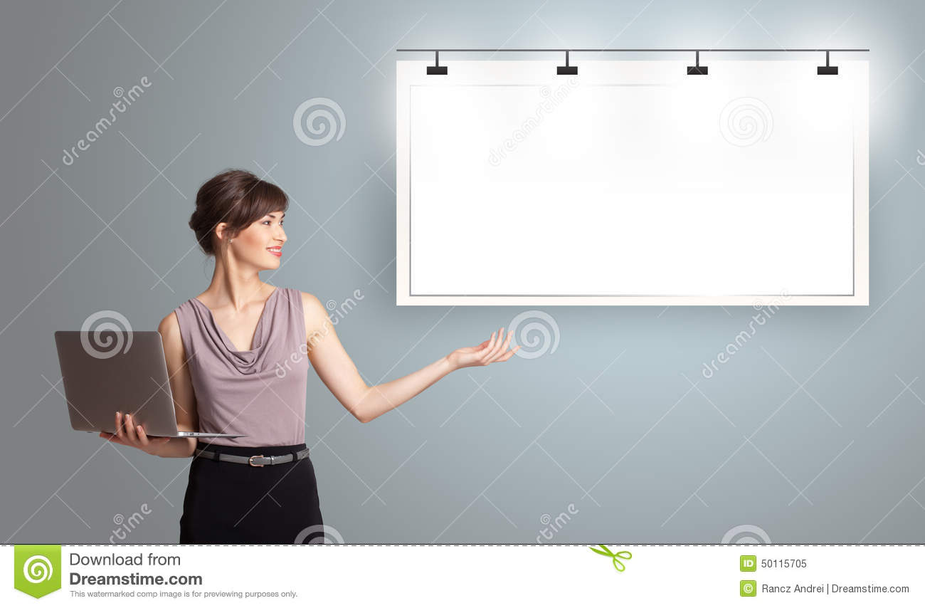 Young woman holding a laptop and presenting modern copy space