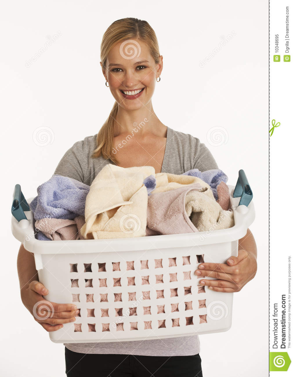 Young Woman Holding Laundry Basket Royalty Free Stock