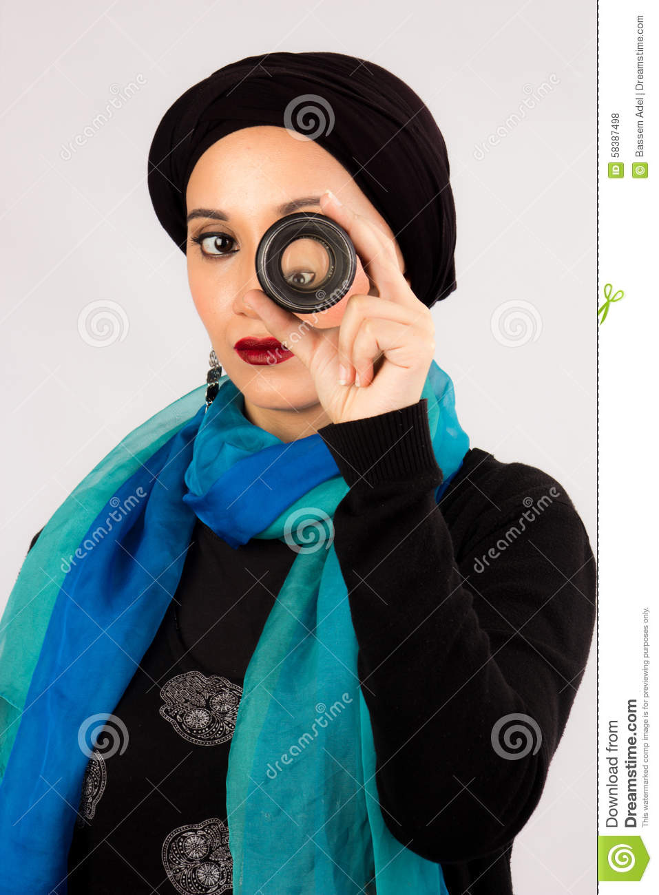 Young Woman Holding A Lens In Hijab And Colorful Scarf Stock Photo Image 58387498